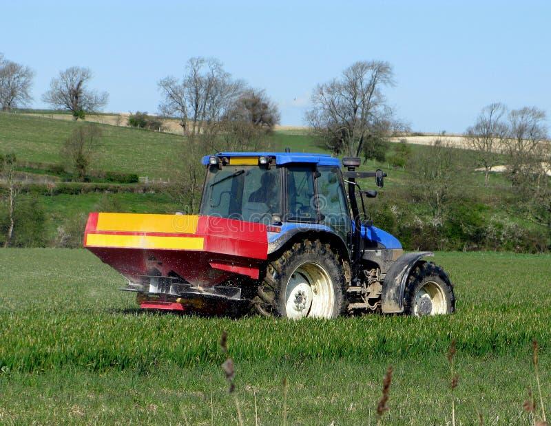 Farmer feeding the crops royalty free stock photo