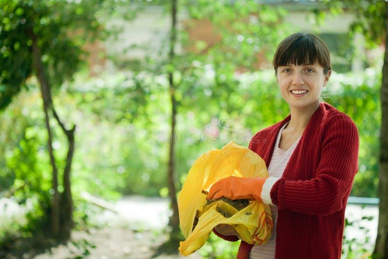 Download Farmer Fertilizes   Soil In Garden Stock Photo - Image: 24066668