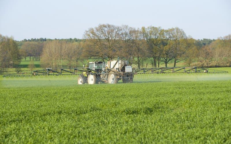 Farmer fertilizing crops stock photography