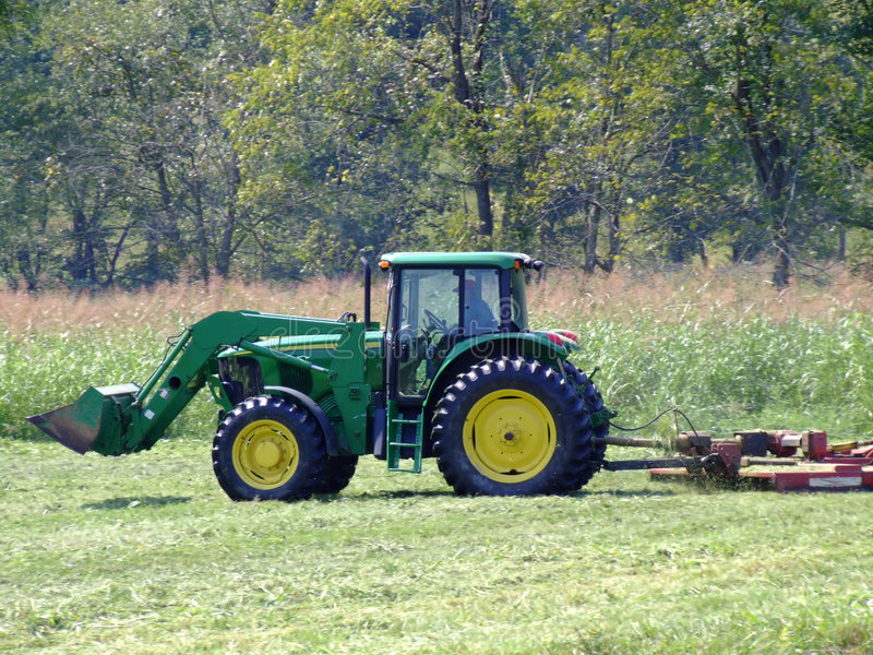 Bush Hog Truck : Farmer with frontloader and bush hog on his tractor
