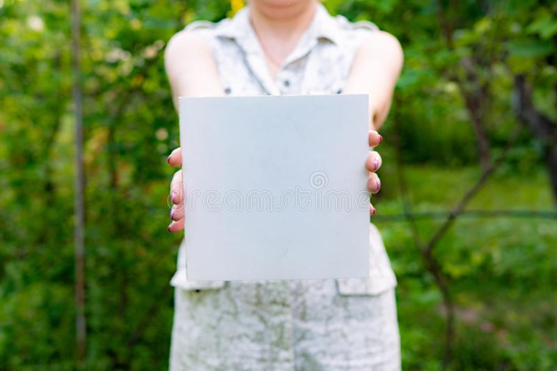 farmer hands holding a square white empty frame with copy spaces stock photos