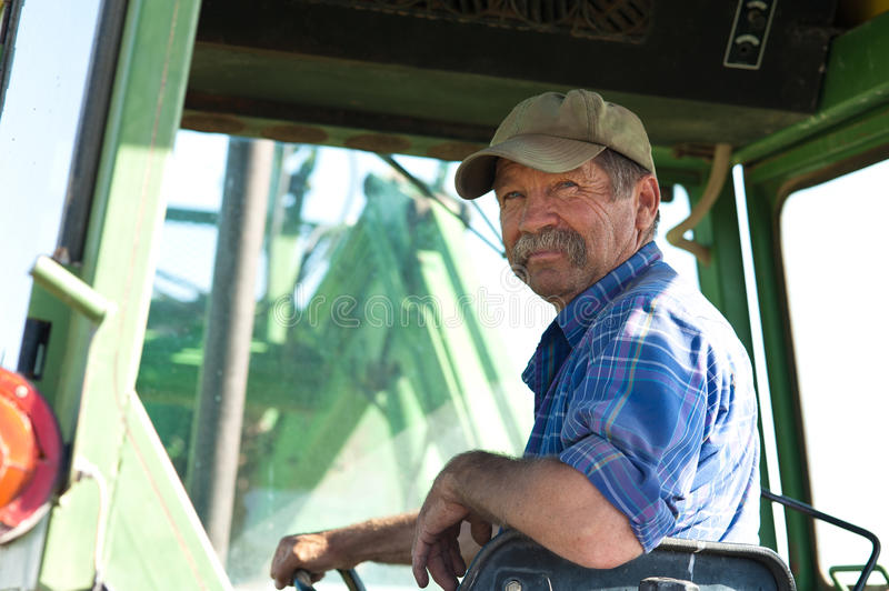 Download Farmer in his Tractor stock image. Image of mature, moustache - 33722935