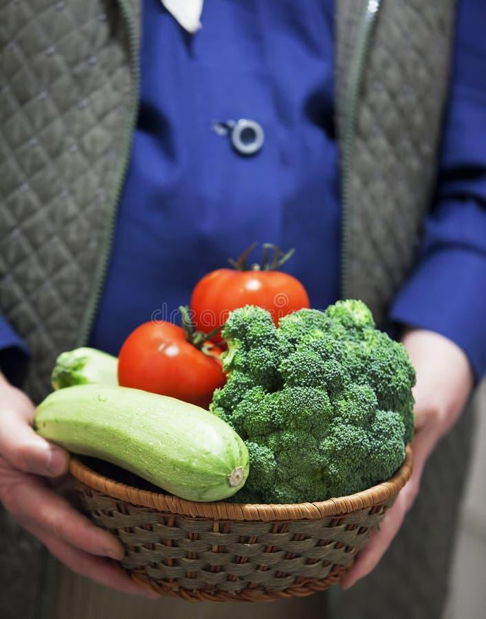 Farmer holding fresh tomato stock image