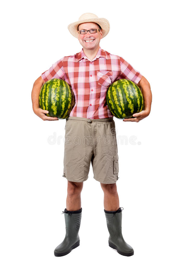 Farmer holding two watermelon stock photography