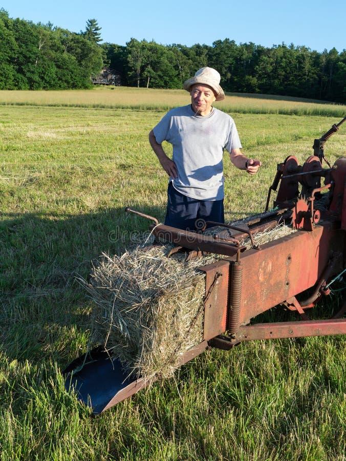 Farmer Making Hay Bales stock photos