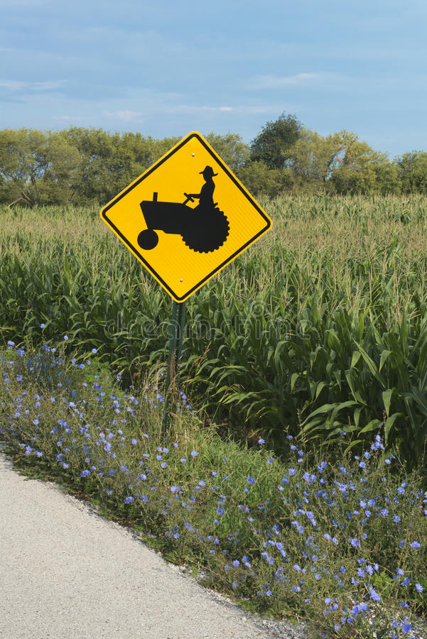 Free Farmer On Tractor Road Waring Sign Royalty Free Stock Images - 26438309
