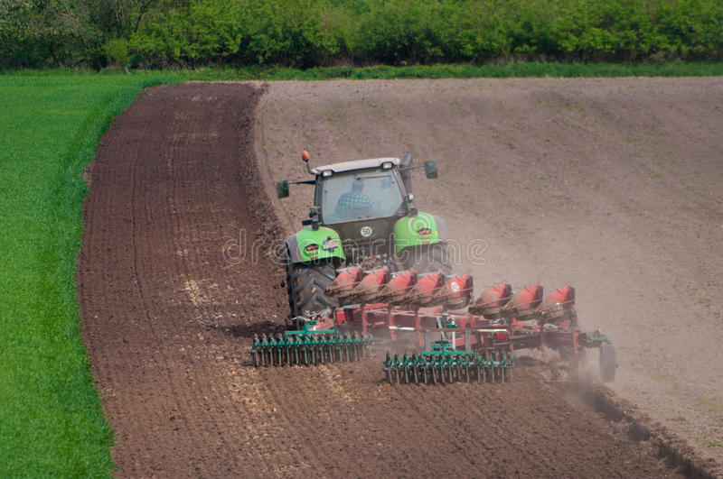 Farmer ploughing field. In Germany royalty free stock photos