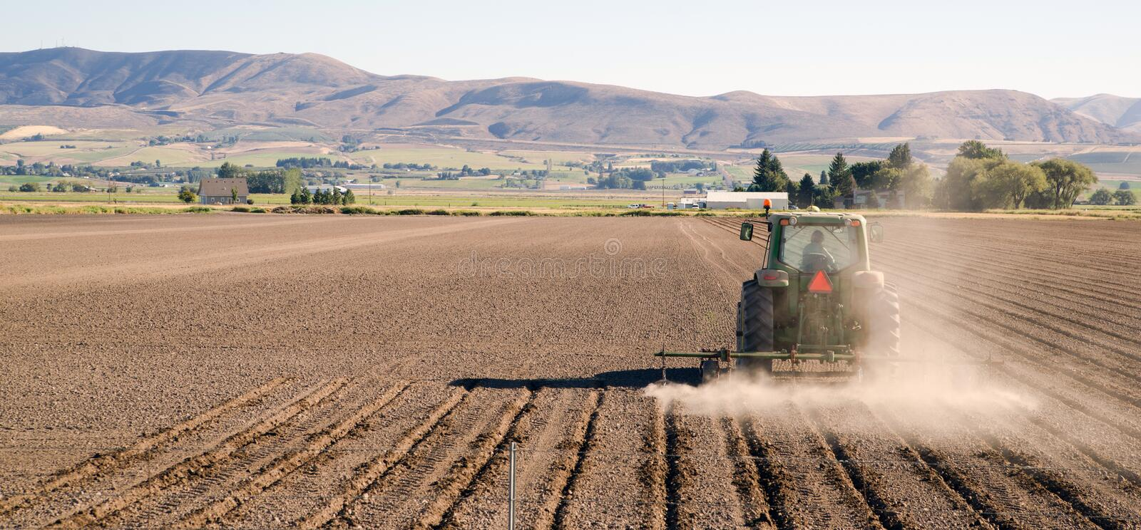 Farmer Plows Rows Fall Planting Tractor Farm Implements royalty free stock photo
