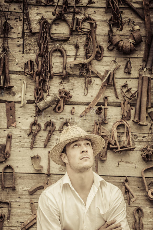 Farmer Portrait in front of a Wall Full of Tools royalty free stock photo
