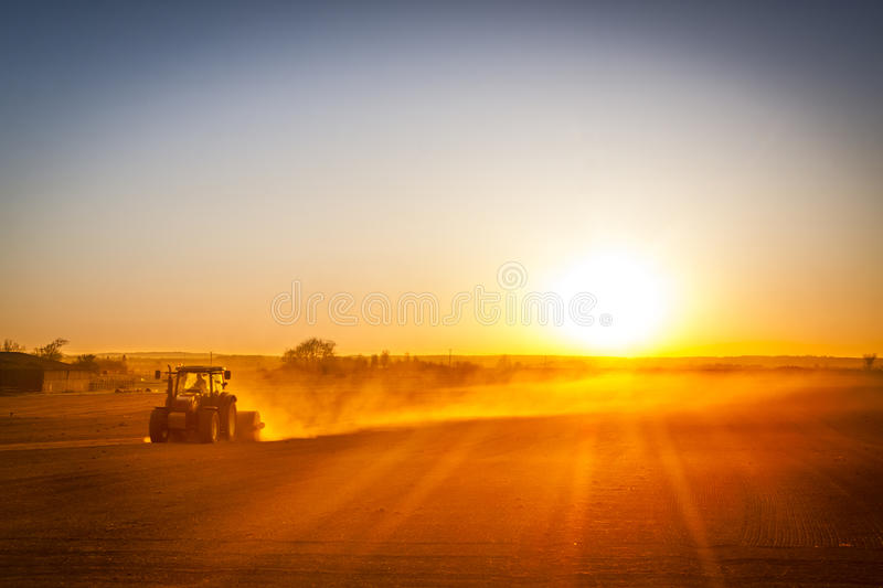 Farmer preparing his field in a tractor ready for spring stock photography