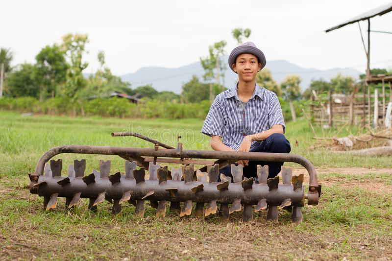 Farmer repair tractor rotary at farm royalty free stock photography