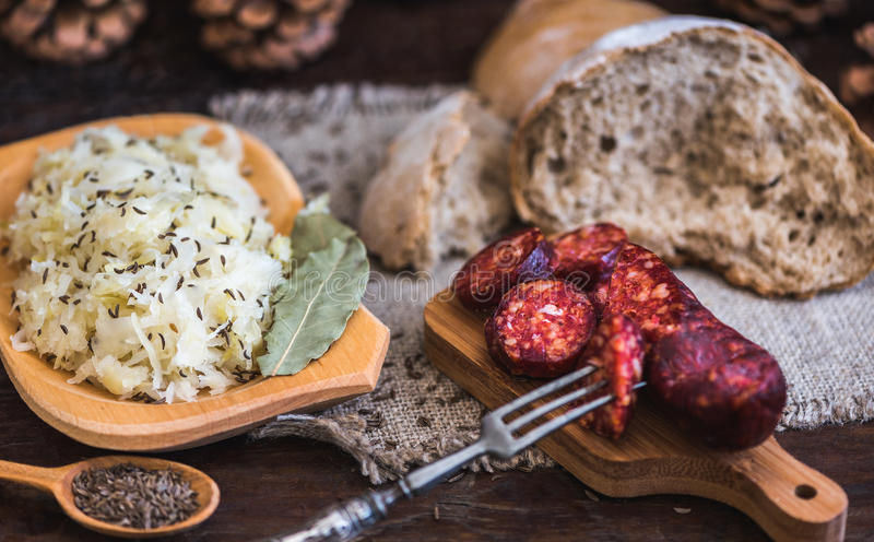 Farmer`s Breakfast, Sausage and Sour Cabbage. Farmer`s Breakfast. Sausage, Sour Cabbage and Bread. Raw Ingredients and Seasoning royalty free stock photography