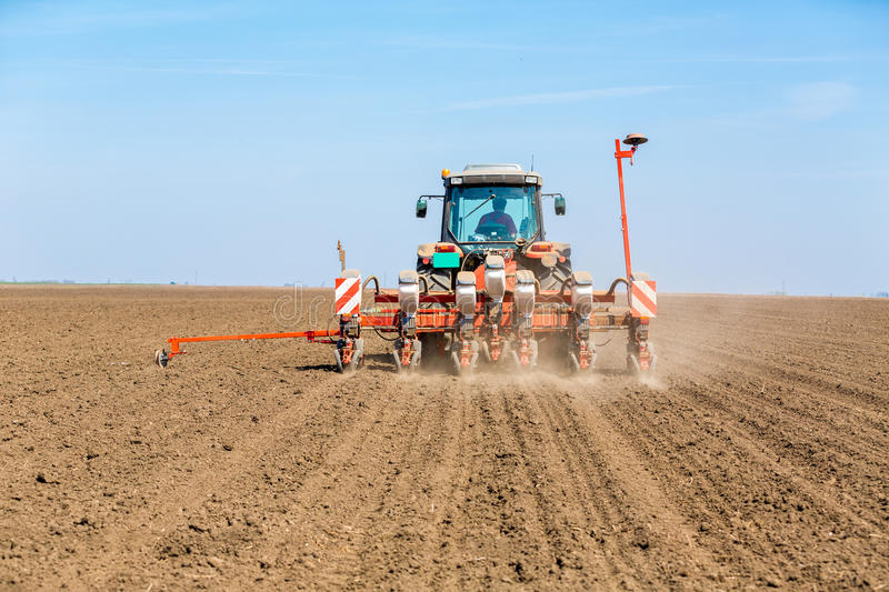 Farmer seeding soybeans with pneumatic seeder. Farmer seeding soybeans with pneumatic seeder stock photography