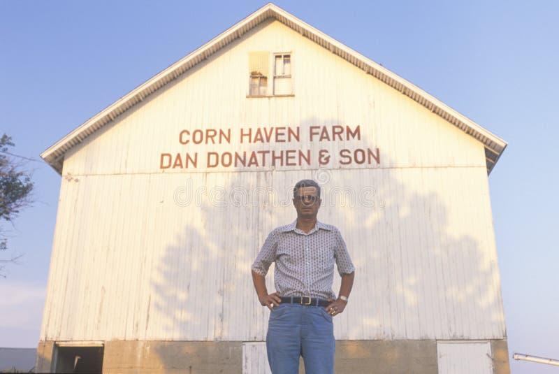 Farmer standing in front of corn barn