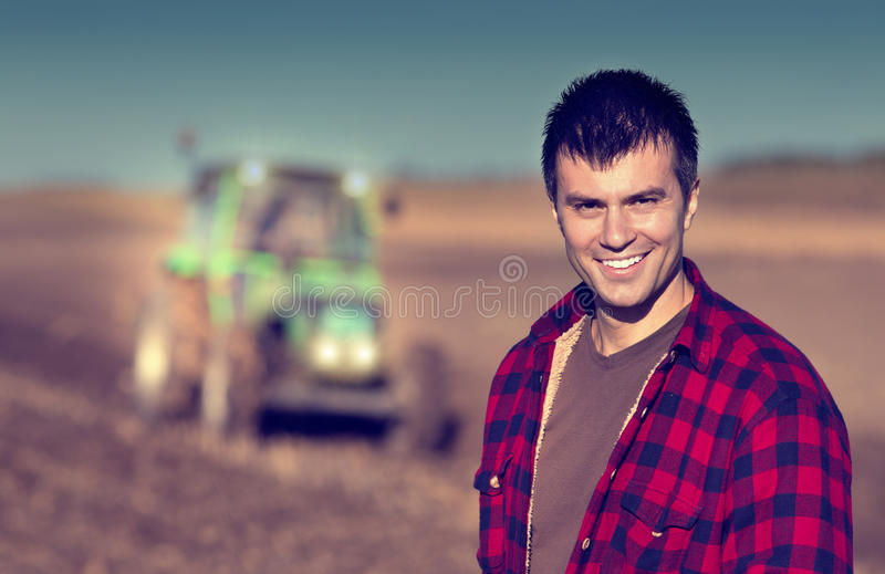 Download Farmer With Tractor On Field Stock Photo - Image of peasant, industry: 62337214