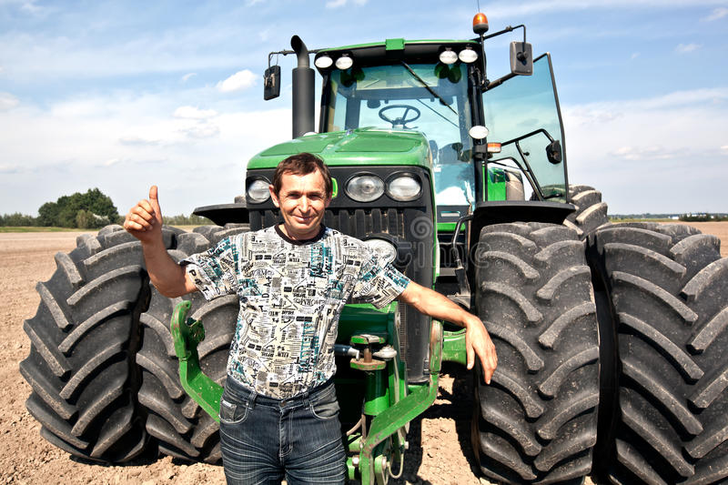 Farmer With Tractor Showing OK Gesture Royalty Free Stock Photo