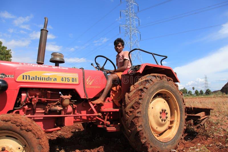 A farmer in a tractor royalty free stock photos