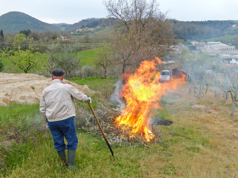 Farmer watching over a fire royalty free stock photo