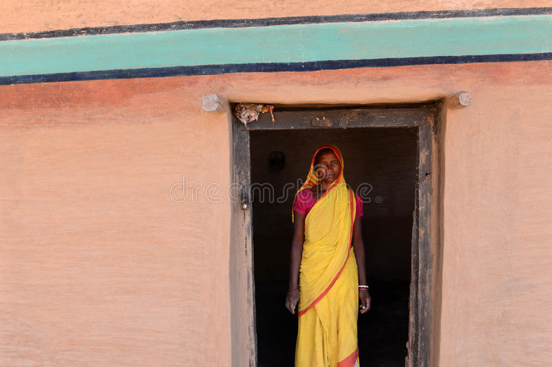 Farmer Woman. A farmer woman posed in her painted home at the remote village of westbengal-India stock photo