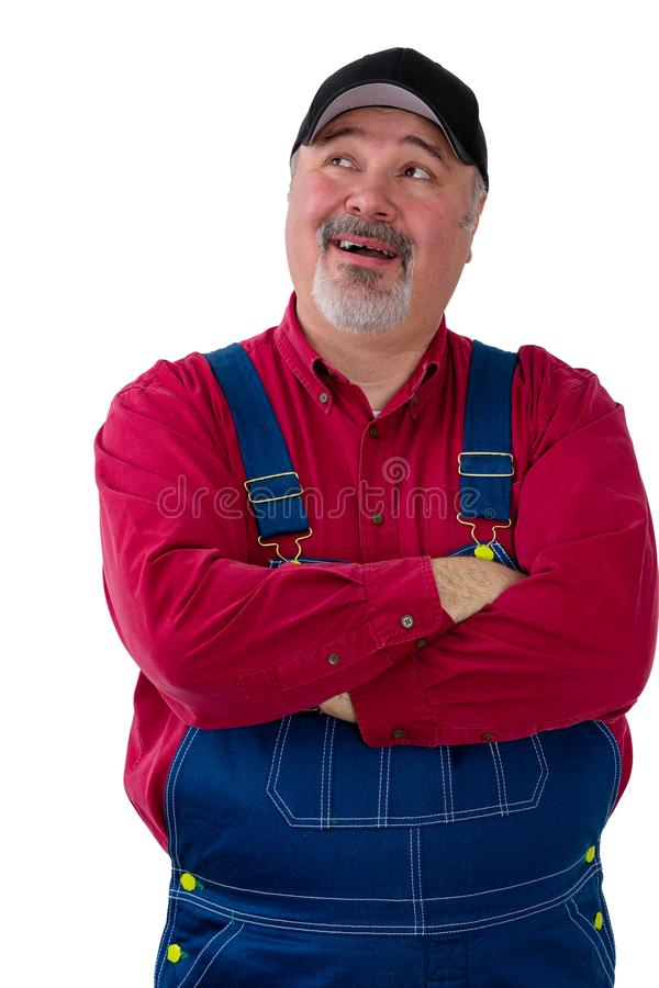 Farmer or worker in dungarees looking up royalty free stock photography