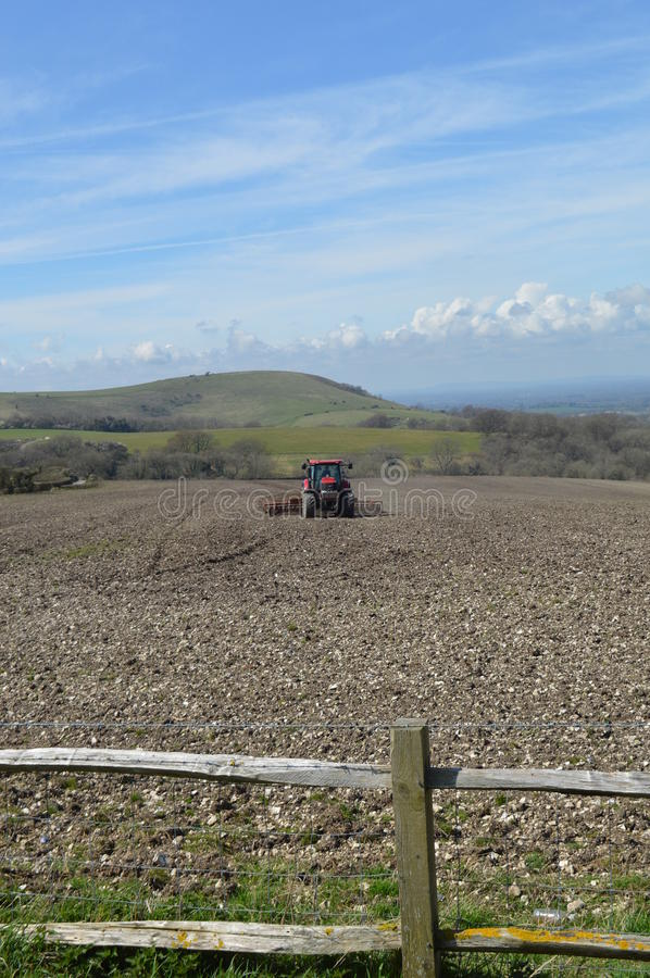 Farmer working his crop field in Sussex. stock image