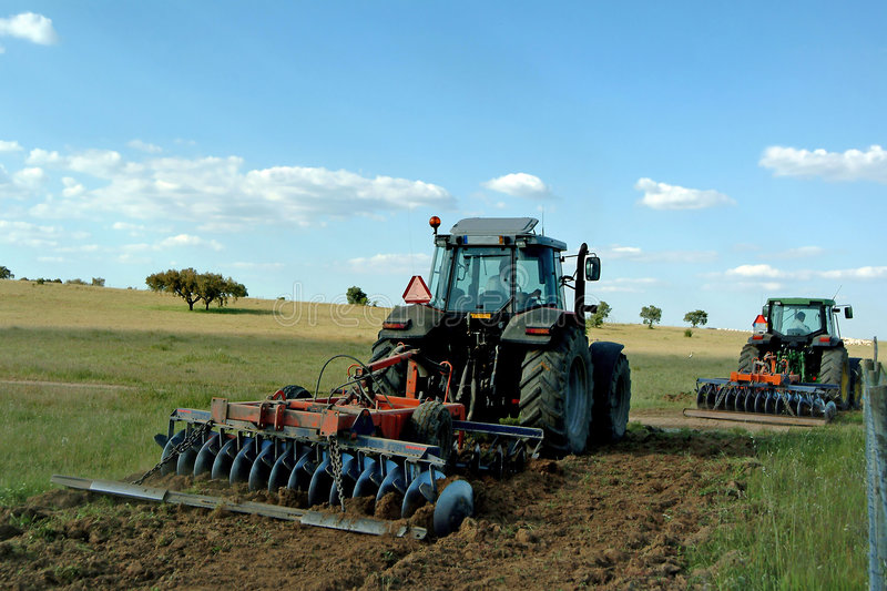 Farmers cultivating. The field stock photography
