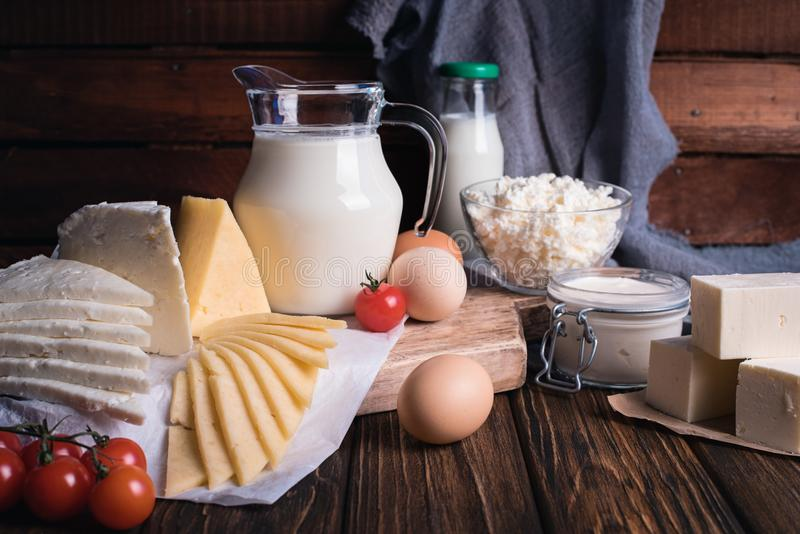 Farmers food products: milk, cream, cheese, eggs, cottage, butter. Rustic composition. Organic food concept stock photos