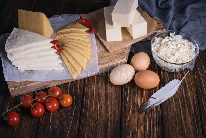 Farmers food products: milk, cream, cheese, eggs, cottage, butter. Rustic composition. Organic food concept stock photography