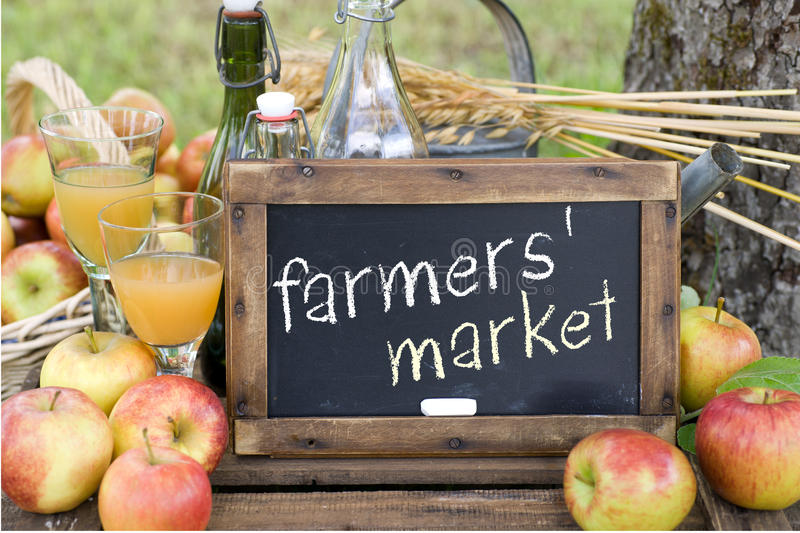 Farmers' market. Fresh apples and chalkboard on a wooden box: Farmers' market stock images