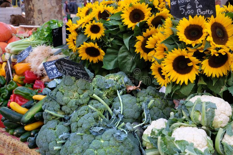 Farmers market in France with vegetables and sunflowers. stock photo