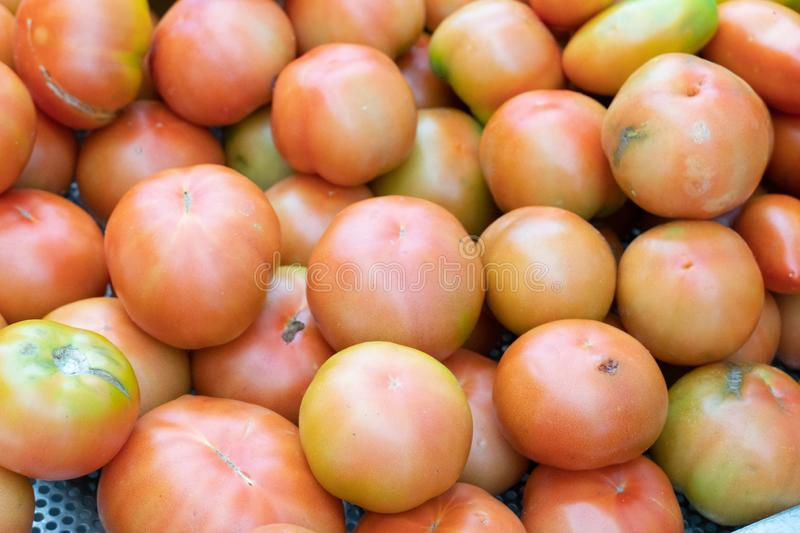 Fresh tomatoes. Farmers` market stall: heap of fresh tomatoes for sale stock photos