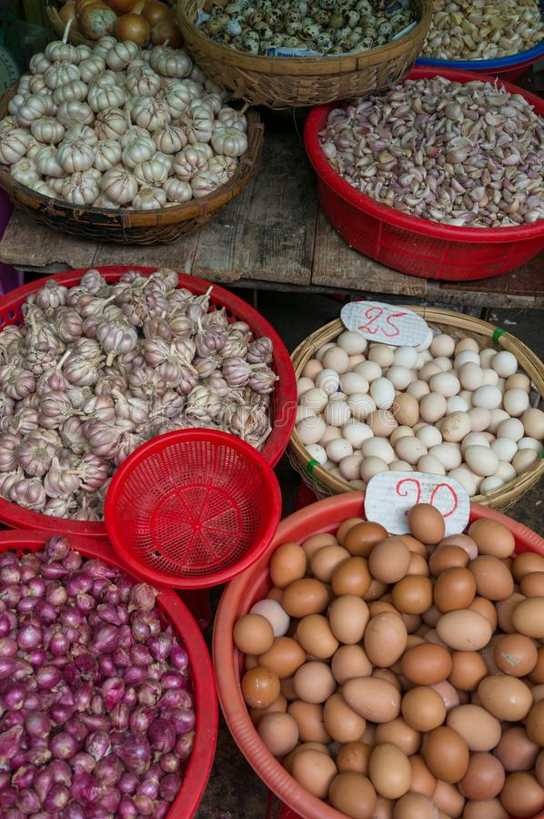 Farmers market stall selling fresh eggs and garlic. Farmers market produce background royalty free stock image