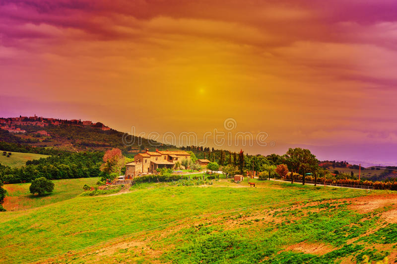 Farmhouse. Big Farmhouse Surrounded by Fields in Tuscany at Sunset royalty free stock photography
