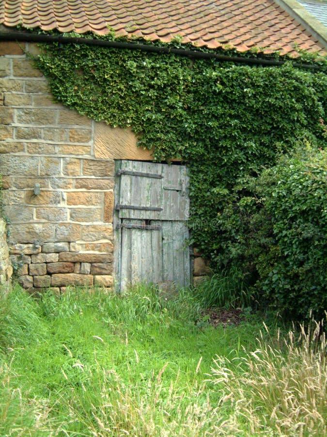 Farmhouse door. Old farm door, set in a stone wall of an old barn, Yorkshire royalty free stock photos