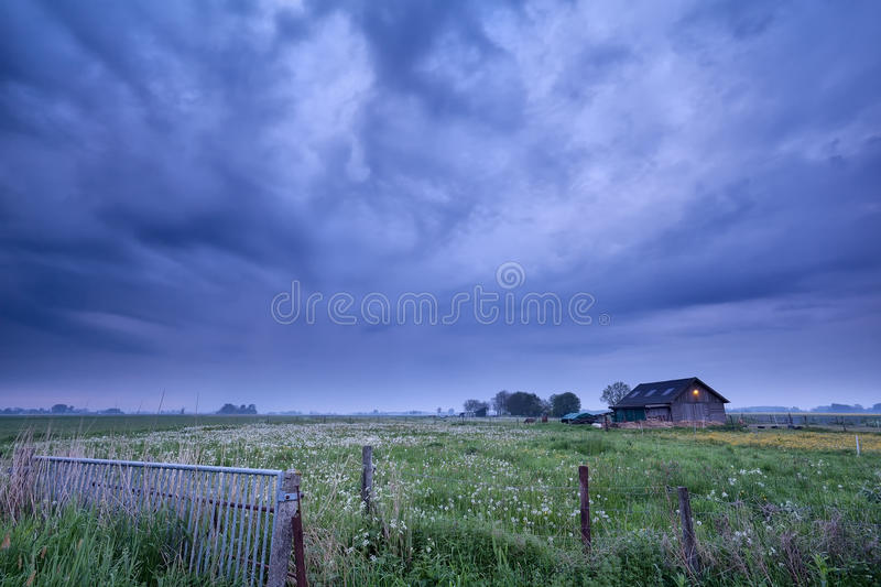 Farmhouse in dusk royalty free stock images