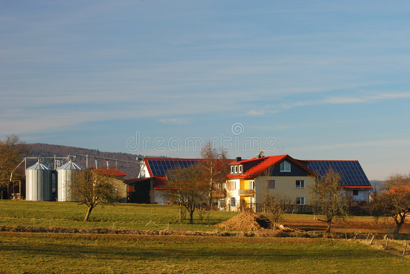 Farmhouse with solar panels. On the roof royalty free stock photography
