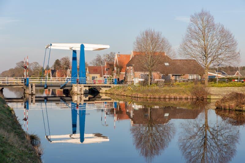 Drawbridge over canal near Smilde in Drenthe, The Netherlands. Farmhouses and drawbridge over canal near Smilde in Drenthe, The Netherlands stock image