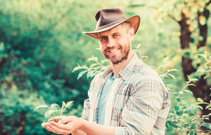 Farming and agriculture cultivation. Gardening. muscular ranch man in cowboy hat care plants. Eco farm worker. Earth day stock photos
