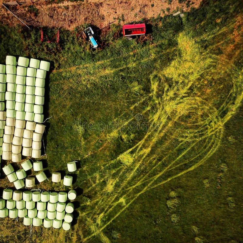 Farming bailing and tractor tracks Arial shot ,view from above looking down royalty free stock photography