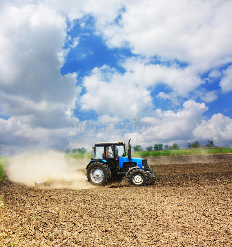 Download Farming tractor in a field stock image. Image of machinery - 24820283