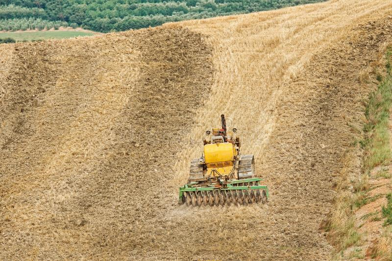 Download Farming With Tractor And Plow In Field Stock Image - Image: 15197577