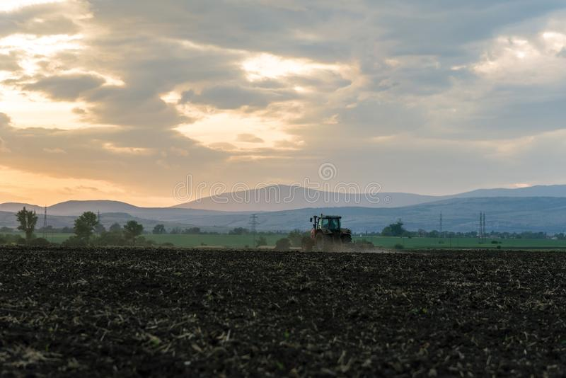 Tractor plowing fields. royalty free stock photography