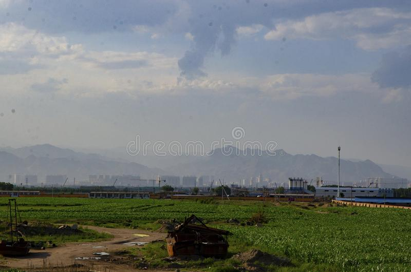 Farmland and distant mountains royalty free stock photo