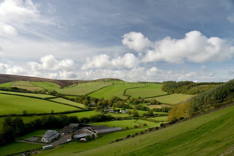 Farmland in Doone Valley, Exmoor, North Devon. Farmland landscape of fields and hedges near Malmsmead in Doone Valley, Exmoor, North Devon stock image
