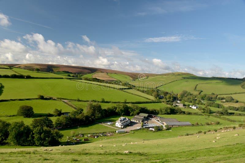 Farmland in Doone Valley, Exmoor, North Devon. Farmland landscape of fields and hedges near Malmsmead in Doone Valley, Exmoor, North Devon royalty free stock image
