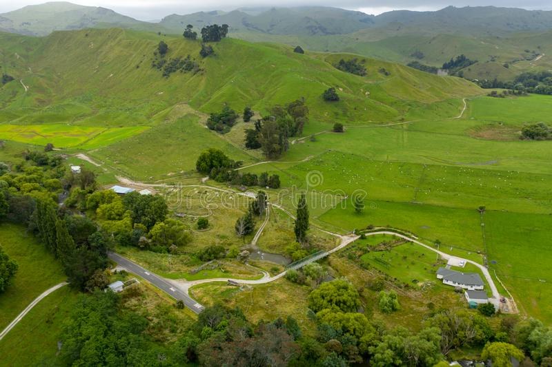 Country Road Aerial View, Rolling Hills of New Zealand Countryside stock photos