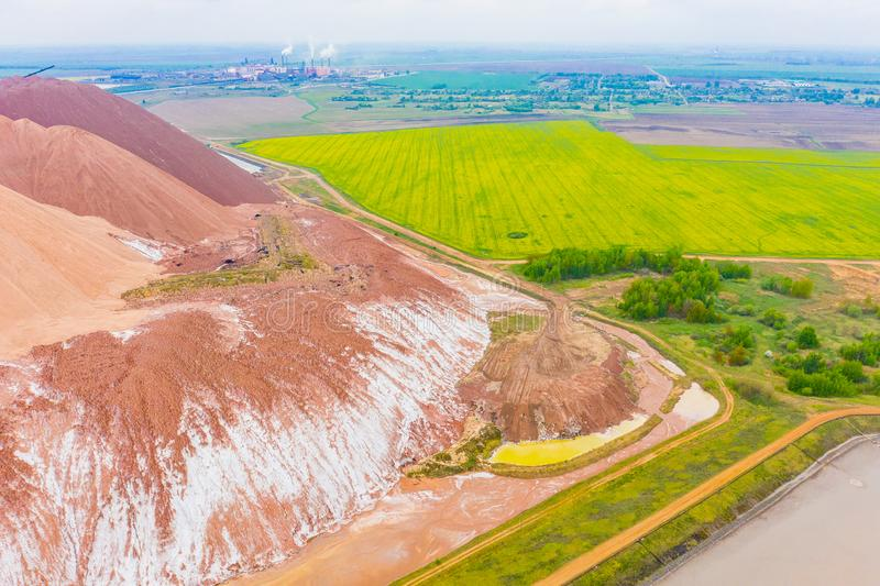 Farmlands near industrial area. Ecological disaster. Farmlands cutivated near industrial area. Ecological disaster, aerial view. Beautiful landscape royalty free stock image