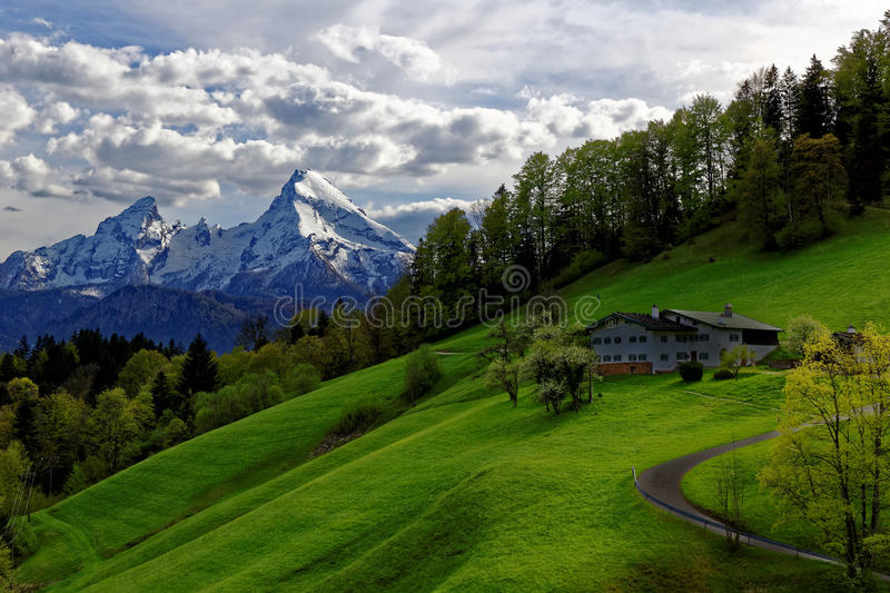 Farmstead in scenic landscape of Bavarian Alps in spring royalty free stock photography