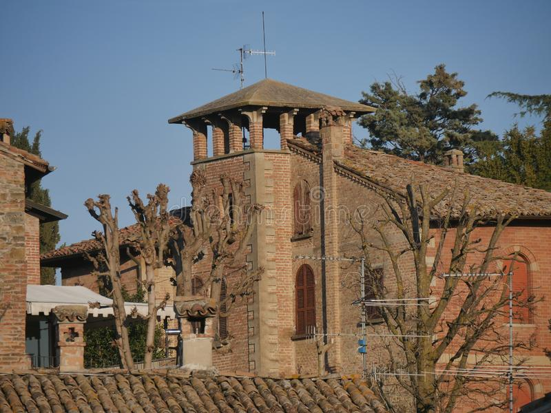 Farnese Tower in Castell`Arquato. Farnese Tower was a military building made of bricks and surmounted by a sighting loggia stock photo