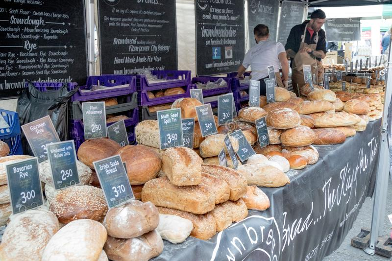 Goods for sale at Farnham Food Festival. Farnham, United Kingdom, 30th October 2017:-Bread for sale on a stall at Farnham International Food Festival stock images